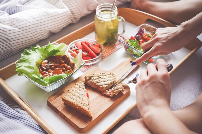 young-woman-enjoying-morning-breakfast-in-bed-2-picjumbo-com