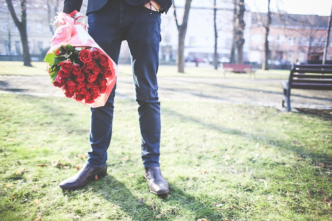 gentleman-holding-a-bouquet-of-roses-picjumbo-com